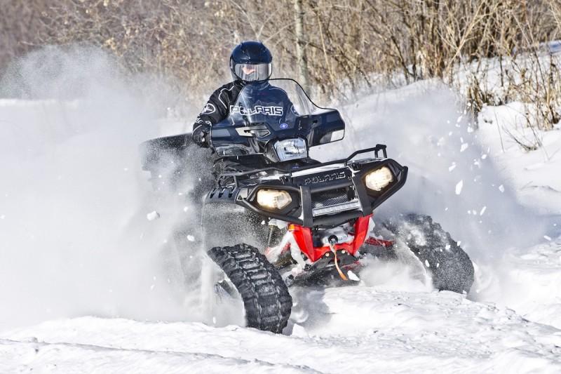 Tracks can turn any ATV into an all-terrain tank, ready to go anywhere, year-round. Image courtesy Polaris.