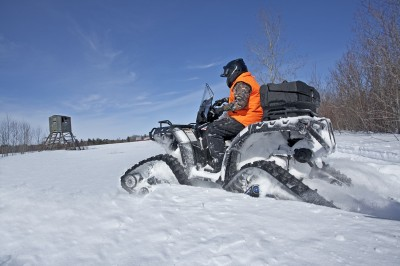 Late-season hunting means getting back into the snow-covered woods for hunters in Northern climates. ATVs set up right can be a big help. Image courtesy Polaris.