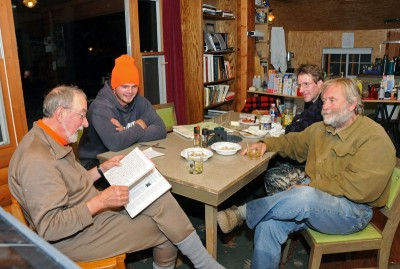 Tom Heberlein, left, relives a hunting story written in the logbook that he keeps at his deer shack in northwestern Wisconsin.