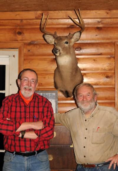 "Tom Heberlein, left, and Ben Niemann, share the story of ""Schleppus,"" a buck Niemann killed in 1982."