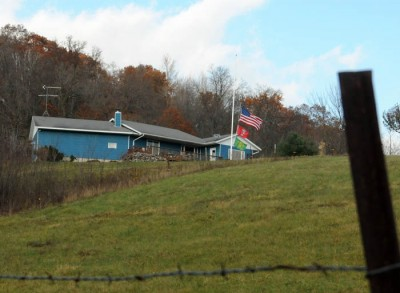Three flags fly at half-staff at Joseph T. Durkin's home in rural Wisconsin to honor his memory.