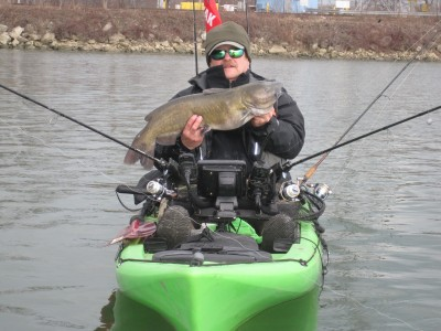 This Michigan kayak angler knows the blue cats continue feeding through the coldest winter months. Image by Lucian Gizel.