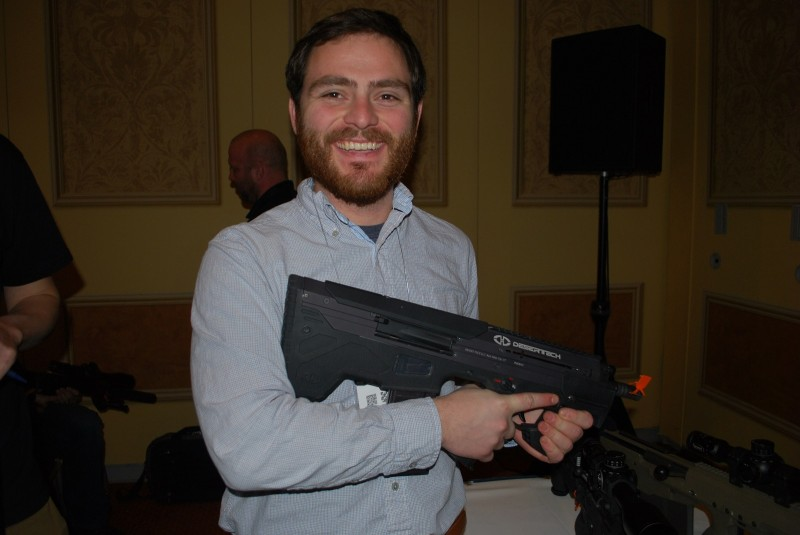 More evidence that bullpups make you smile. OutdoorHub's Eddie Pierz with the MDR-C. Beard for scale.