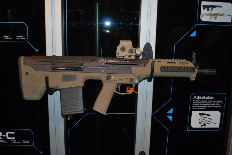 A .308 MDR with FDE furniture and an EOTech on the top rail. The backup iron sights are also deployed.