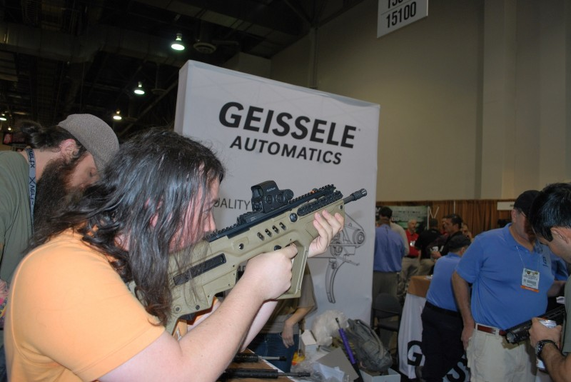 A SHOT Show attendee tests the Geissele Tavor trigger.