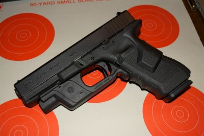 If you carry a mid-size or full size gun, you can easily add a light and laser, like this Glock 17 with Crimson Trace Lasergrip and Lightguard.