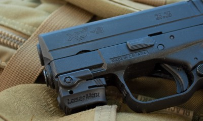 Even a pocket-sized gun like this Springfield Armory XD-S can be equipped with a laser, like this LaserMax Mini.