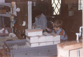 Back in the day, even little brother Nick helped out stamping boxes.