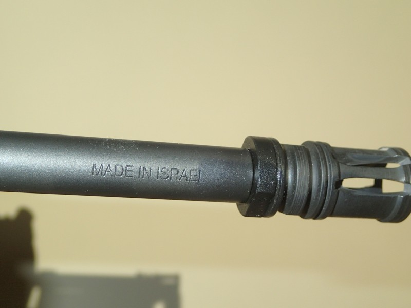 A mark of quality on the Tavor's barrel.