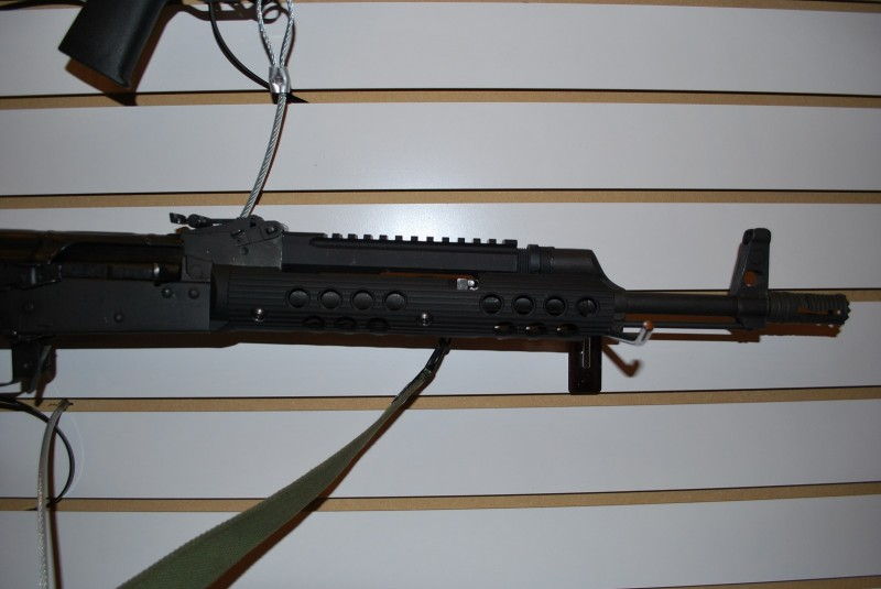 A close-up shot of Troy's railed AK gas block and short handguard.
