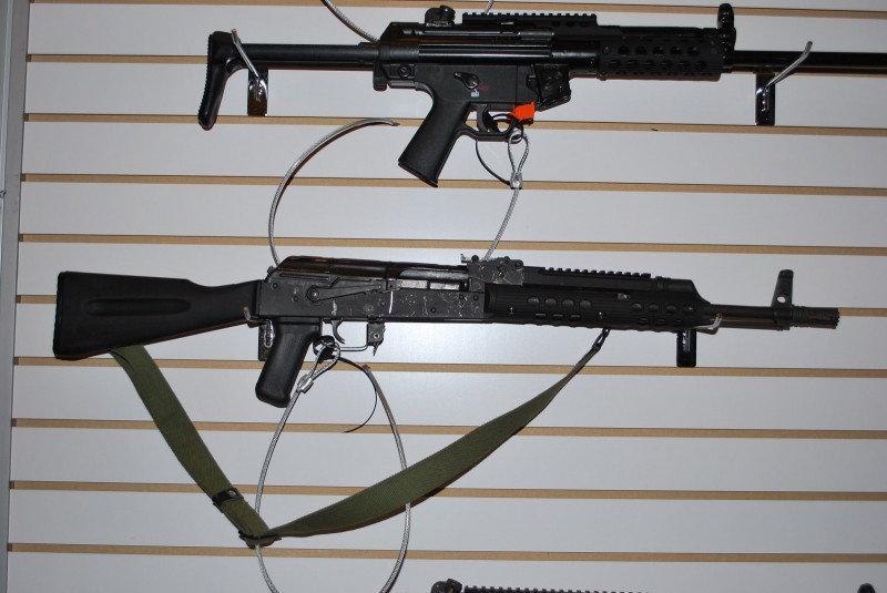 An AK on display at the Troy booth outfitted with the railed gas block and short handguard.