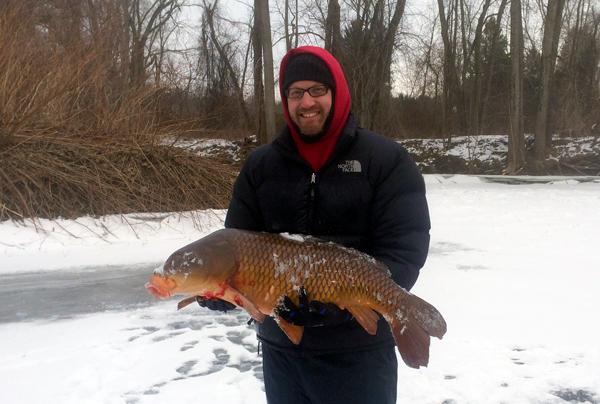 Andrew Plumridge with his massive carp. Image courtesy Andrew Plumridge.