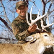 Tony Stewart with a big buck on a bowhunting trip.