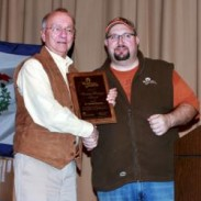 Dr. David Samuel (left) receives the 2013 Whitetails Unlimited Hunting HeritageLifetime Achievement Award from WTU Field Director Dennis Malloy at the West Virginia First Mountaineer Chapter Hunters Night Out banquet in Wheeling, West Virginia on Saturday, February 8.