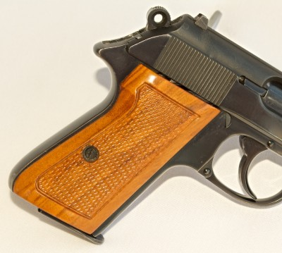 """The Walther's trigger is radiused, top strap """"anti-glared"""" and the wood grips are even glass bedded to perfectly fit the frame."""