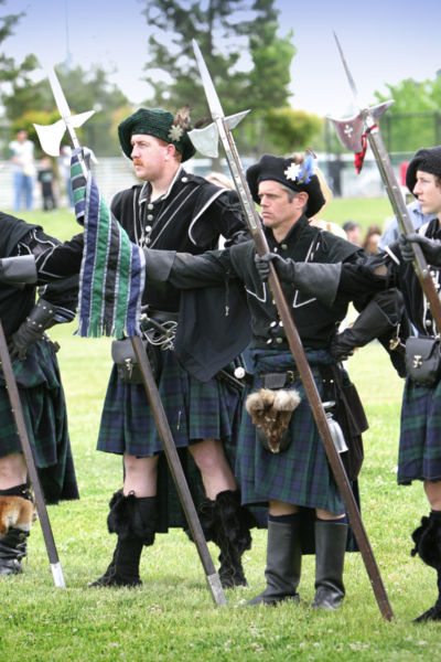 These are halberds (the weapons, not the Scottish reenactors).