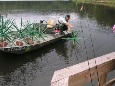 The Kentucky Department of Fish & Wildlife sinks Porcupine Fish Attractors to attract crappies and other gamefish within casting range of a public fishing dock.