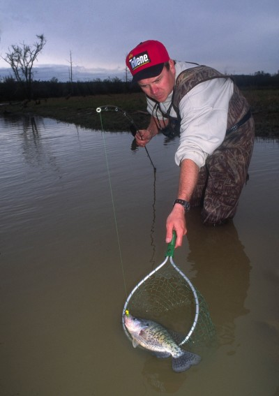 Wade fishing in shallow water is a great way to find and catch spawning crappie at this time of the year.