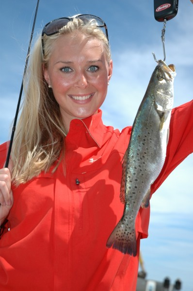 Roseanne Patton with a school-size speckled trout caught under the birds out of Bay St. Louis, Mississippi.