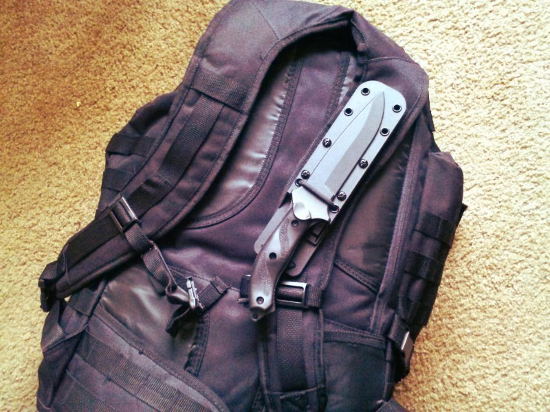 I attached this Nighthawk utility knife across one of the shoulder straps. Despite this carry position being trivialized by Hollywood, I find that its handy place to put a knife and takes weight off your legs.