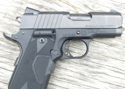 This Para Executive Carry has a grip-mounted laser with the activation button in front. The author believes this is the best system because activating the laser is easy and requires no conscious effort.