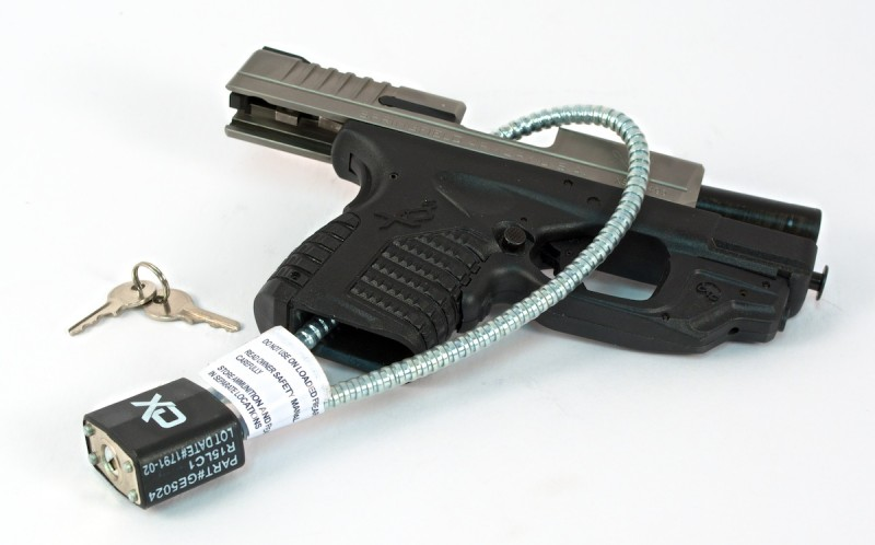 Gun safety in the home can be as easy as using a gun lock, seen here. Gun locks are available for free thanks to industry partners and the National Shooting Sports Foundation. Image by Tom McHale.