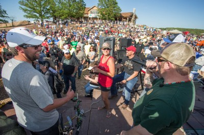 """Brian Quaca of Sportsman's Channel, """"Pigman: The Series,"""" on stage during the U.S. Open Bowfishing Championship."""
