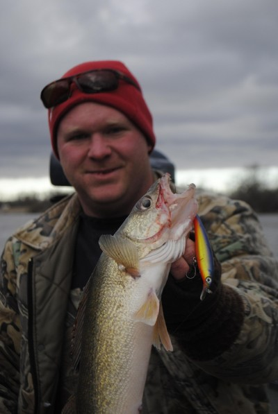 Cody Deatsman shows off an opening day walleye taken on a Rapala.