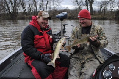 Greg Sochocki, left, and Cody Deatsman compare Tittabawassee River walleyes.