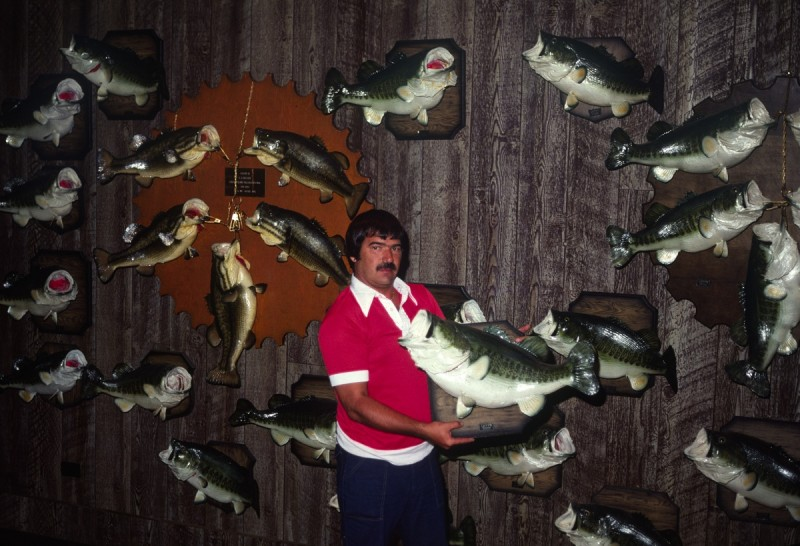 Pictured here is the late LJ Brasher, with his wall full of 10-pound-plus bass that he caught primarily at night, fishing small public ponds on the Florida/Georgia line.