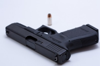 Two Glock executives stand accused of taking more than $1 million in bribes.