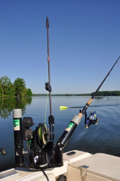 Muskie angler Paul Anderson gets double duty out of his downriggers by using them as powered planerboard masts.