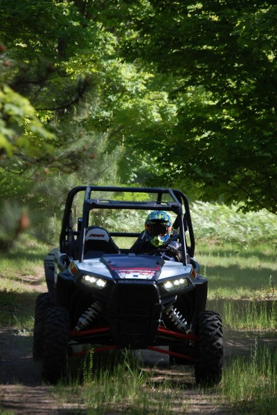 The RZR XP 4 1000 is a long, wide machine that is too big for some trails, but just right for others. Image by Brandie Sigler.