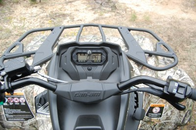 Engaging the Visco-Loc differential is as simple as flipping a rocker switch on the right grip. The digital display is easy to read and the rider is positioned to easily see over the front end at trail obstacles. Image by Derrek Sigler.