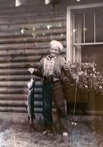 Jim Olson, then 10, with his first muskie in 1949. Image courtesy Jim Olson.