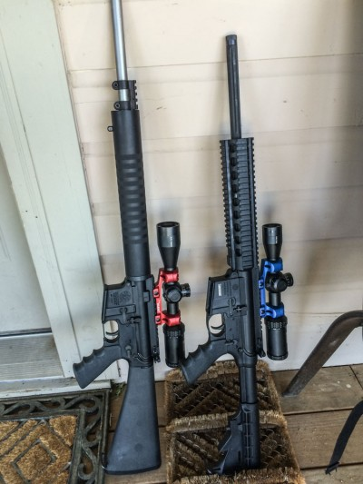 A pair of Smith & Wesson M&P 15 Performance Center rifles. The one on the left is chambered in .22 LR, the one on the right 5.56mm.