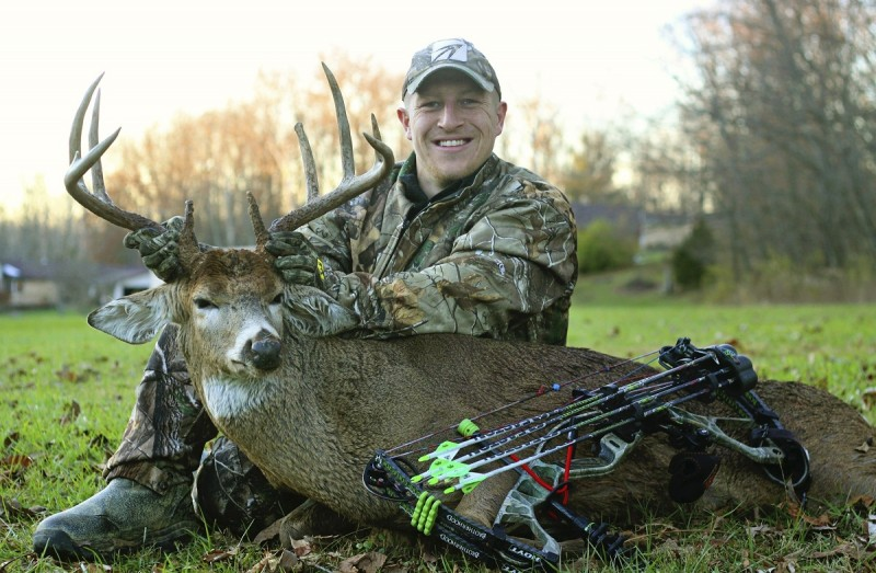Tyler Viars with a buck he harvested in fall 2013. Read on to learn his recipe for a delicious bacon-wrapped backstrap topped with chimichurri!