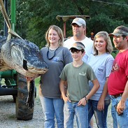 Team members are: (from left) Mandy Stokes, John Stokes, Parker Jenkins, Savannah Jenkins and Kevin Jenkins. The 15-foot gator weighed 1,011.5 pounds.