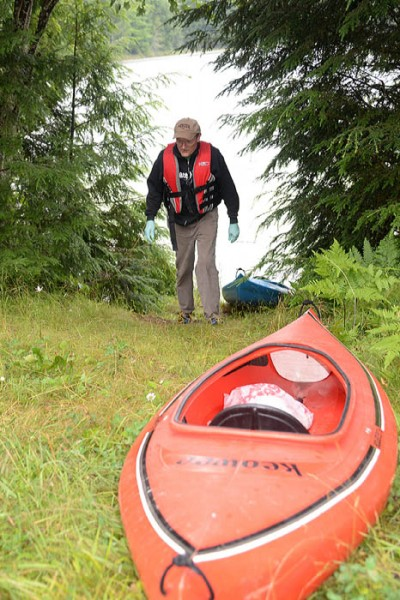 Larry Keen prepares his kayaks to go fishing in Iron County.