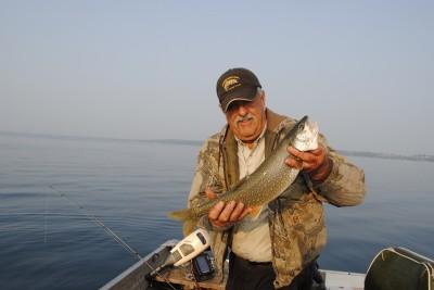 Al Scott admires a Grand Traverse Bay lake trout.