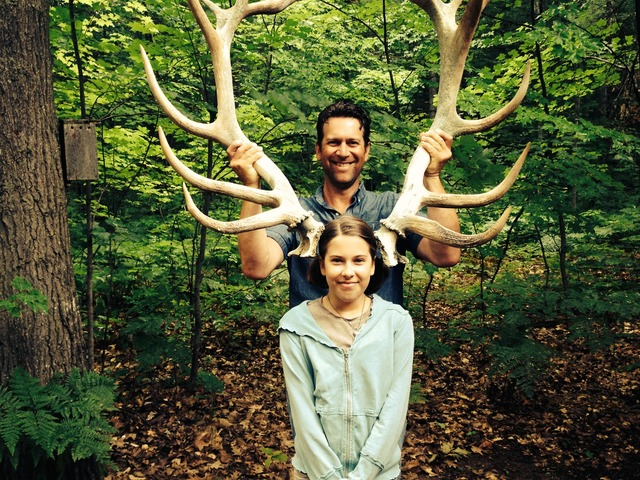 Sonja and David Moehle pose for the camera with some massive antlers.