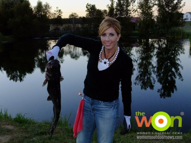 Anietra with a catfish she caught in a small pond. Image by Robbie Hamper.