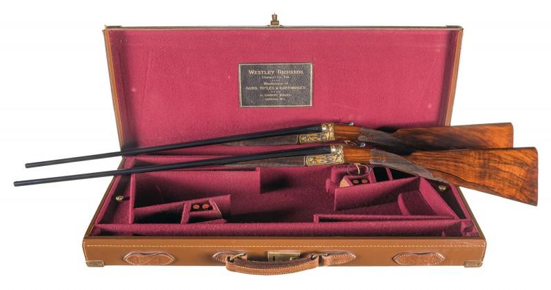 Where will you put this pair of lavishly-adorned shotguns?