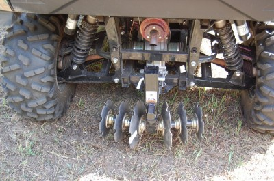The GroundHog MAX disc/plow, mounted here on the back of a Kawasaki Teryx, is an inexpensive and easily portable way to work up ground for food plots, gardens, and more.