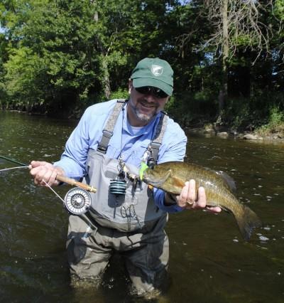 Dirk Fischbach shows off a Flint River smallmouth.