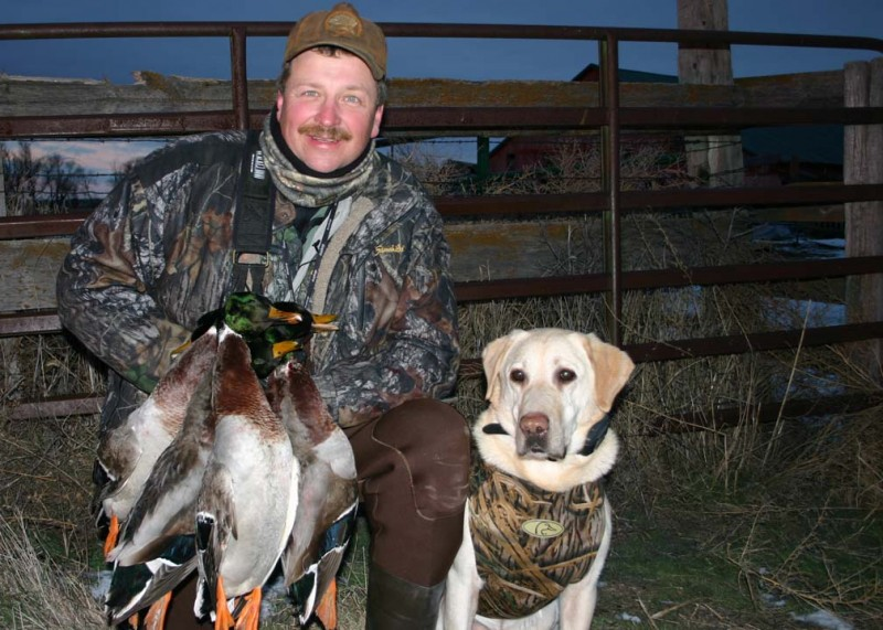 Bill Miller, pictured here with his bird dog Huck, admittedly gets a little Cliff Clavin-like in his obsession for duck identification. Image courtesy Bill Miller.