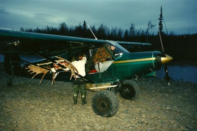 Kurt Lepping's Cessna, sporting some extra weight after a successful moose harvest. Image by Dennis Dunn.