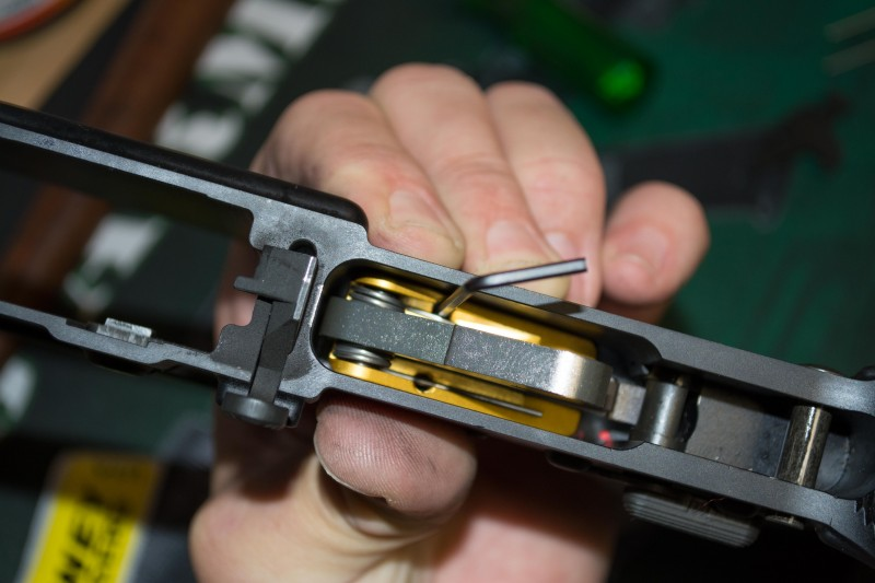 "Tighten two set screws to ""jam"" the trigger group assembly into place, creating pressure against the trigger group pins."