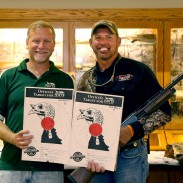 NWTF World Still Target Championships director, Rhett Simmons (left), awards Bobby Sears for setting the new world record in the 12-gauge Hunter Division.