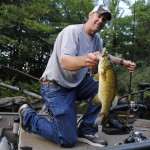 Scott Markham hauls in a nice Kalamazoo River smallmouth, caught on a tube.